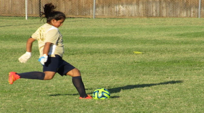 Je suis une fille et je joue au foot en club